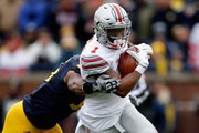 Terry Richardson #13 of the Michigan Wolverines tackles Braxton Miller #1 of the Ohio State Buckeyes during the second quarter at Michigan Stadium on November 28, 2015 in Ann Arbor, Michigan.