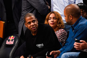 Jay Z sits with Beyonce during a game between the Brooklyn Nets and Oklahoma City Thunder at the Barclays Center on November 3, 2014 in the Brooklyn borough of New York City. NOTE TO USER: User expressly acknowledges and agrees that, by downloading and/or using this photograph, user is consenting to the terms and conditions of the Getty Images License Agreement.