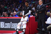 Russell Westbrook #0 and head coach Billy Donovan of the Oklahoma City Thunder look on at half court during the first half against the LA Clippers at Staples Center on January 4, 2018 in Los Angeles, California.