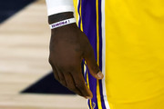 """A detailed view of the """"Lebron James Family Foundation Bracelet"""" worn by LeBron James #23 of the Los Angeles Lakers during the second quarter against the Oklahoma City Thunder at HP Field House at ESPN Wide World Of Sports Complex on August 05, 2020 in Lake Buena Vista, Florida. NOTE TO USER: User expressly acknowledges and agrees that, by downloading and or using this photograph, User is consenting to the terms and conditions of the Getty Images License Agreement."""
