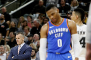 Billy Donovan  looks on as does Russell Westbrook #0 of the Oklahoma City Thunder late in game against the San Antonio Spurs at AT&T Center on November 17, 2017 in San Antonio, Texas.  NOTE TO USER: User expressly acknowledges and agrees that , by downloading and or using this photograph, User is consenting to the terms and conditions of the Getty Images License Agreement.