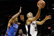 Tony Parker #9 of the San Antonio Spurs goes up for a shot in front of Russell Westbrook #0 of the Oklahoma City Thunder in the first quarter in Game Two of the Western Conference Finals of the 2012 NBA Playoffs at AT&T Center on May 29, 2012 in San Antonio, Texas. NOTE TO USER: User expressly acknowledges and agrees that, by downloading and or using this photograph, user is consenting to the terms and conditions of the Getty Images License Agreement.