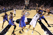Tony Parker #9 of the San Antonio Spurs is fouled by Russell Westbrook #0 of the Oklahoma City Thunder in the second quarter in Game Two of the Western Conference Finals of the 2012 NBA Playoffs at AT&T Center on May 29, 2012 in San Antonio, Texas. NOTE TO USER: User expressly acknowledges and agrees that, by downloading and or using this photograph, user is consenting to the terms and conditions of the Getty Images License Agreement.