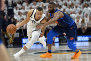 Dante Exum #11 of the Utah Jazz drives around Raymond Felton #2 of the Oklahoma City Thunder in the first half during Game Four of Round One of the 2018 NBA Playoffs at Vivint Smart Home Arena on April 23, 2018 in Salt Lake City, Utah. NOTE TO USER: User expressly acknowledges and agrees that, by downloading and or using this photograph, User is consenting to the terms and conditions of the Getty Images License Agreement.