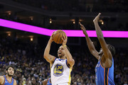 Stephen Curry Jerami Grant Photos Photo