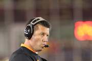 Head coach Mike Gundy of the Oklahoma State Cowboys looks on in frustration against the Iowa State Cyclones  at Jack Trice Stadium November 18, 2011 in Ames, Iowa.