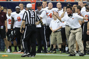 Oklahoma State Cowboys head coach Mike Gundy reacts to to a flag thrown on the play as officials sort out the penalty during the Advocare Texas Kickoff between Mississippi State Bulldogs and Oklahoma State Cowboys at Reliant Stadium on August 31, 2013 in Houston, Texas.