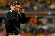 Head coach Mike Gundy of the Oklahoma State Cowboys looks on while taking on the Missouri Tigers during the AT&T Cotton Bowl on January 3, 2014 in Arlington, Texas.