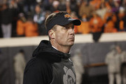 Head Coach Mike Gundy of the Oklahoma State Cowboys leaves the field after the game against the Oklahoma Sooners November 28, 2015 at Boone Pickens Stadium in Stillwater, Oklahoma. Oklahoma defeated Oklahoma State 58-23.