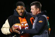Head coach Mike Gundy of the Oklahoma State Cowboys embraces Ryan Simmons #52 of the Oklahoma State Cowboys before a game against the Oklahoma Sooners at Boone Pickens Stadium on November 28, 2015 in Stillwater, Oklahoma.