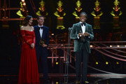 Katharine McPhee and Jack McBrayer present the Best Actor in a Musical award to Kobna Holdbrook-Smith on stage, during The Olivier Awards 2019 with Mastercard at the Royal Albert Hall on April 07, 2019 in London, England.
