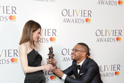 Shirley Henderson, winner of the Best Actress In A Musical award for 'Girl From The North Country', and poses with Cuba Gooding Jr in the press room during The Olivier Awards with Mastercard at Royal Albert Hall on April 8, 2018 in London, England.