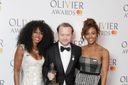 Michael Jibson, (C) winner of the Best Actor In A Supporting Role In A Musical' for 'Hamilton', poses with Alexandra Burke (R) and Beverley Knight in the press room during The Olivier Awards with Mastercard at Royal Albert Hall on April 8, 2018 in London, England.