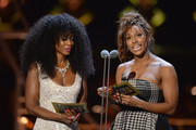 Beverley Knight (L) and Alexandra Burke present the award for Best Actor In A Supporting Role In A Musical on stage during The Olivier Awards with Mastercard at Royal Albert Hall on April 8, 2018 in London, England.