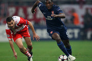 Gilles Sunu of Arsenal goes past Giorgos Galitsios of Olympiakos during the UEFA Champions League Group H match between Olympiakos and Arsenal at the Georgios Karaiskakis Stadium on December 9, 2009 in Athens, Greece.