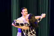 """Olympian Ryan Lochte (L) and dancer Cheryl Burke rehearse for their """"Dancing with the Stars"""" performance with the cast of """"O by Cirque du Soleil"""" at the Bellagio on September 30, 2016 in Las Vegas, Nevada."""