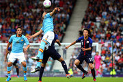 Javier Martinez of Spain heads the ball while Koke (L) and Kensuke Nagai of Japan look on during the Men's Football first round Group D Match of the London 2012 Olympic Games between Spain and Japan , at Hampden Park on July 26, 2012 in Glasgow, Scotland.