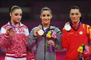 (R-L) Silver medalist Catalina Ponor of Romania, gold medalist Alexandra Raisman of the United States of America and bronze medalist Aliya Mustafina of Russia pose on the podium during the medal ceremony for the on Day 11 of the London 2012 Olympic Games at North Greenwich Arena on August 7, 2012 in London, England.