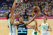 Brazilian guard Anderson Varejao (L) challenges Argentinian guard Emanuel Ginobili during their men's quarterfinal basketball match on Day 12 of the London 2012 Olympic Games at the Basketball Arena on August 8, 2012  in London, England.