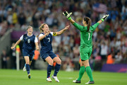 Hope Solo #1, Amy LePeilbet #6 and Christie Rampone #3 of the United States celebrate after defeating Japan by a score of 2-1 to win the Women's Football gold medal match on Day 13 of the London 2012 Olympic Games at Wembley Stadium on August 9, 2012 in London, England.