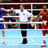 Josh Taylor Photos - Josh Taylor of Great Britain (L) celebrates his victory over Robson Conceicao of Brazil after their Men's Light (60kg) Boxing bout on day 2 of the London 2012 Olympic Games at ExCeL on July 29, 2012 in London, England. - Olympics Day 2 - Boxing