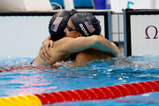 (L-R) Breeja Larson and Rebecca Soni of the United States hug after competing in the Women's 100m Breaststroke semi final on Day 2 of the London 2012 Olympic Games at the Aquatics Centre on July 29, 2012 in London, England.