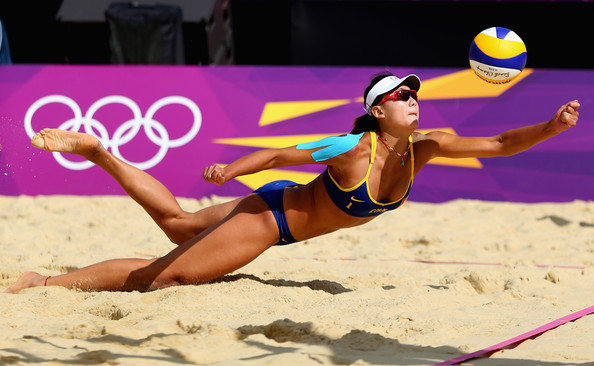 Chen Xue of China dives for a shot during her Women's Beach Volleyball Preliminary match with Xi Zhang of China against Simone Kuhn and Nadine Zumkehr of Switzerland on Day 3 of the London 2012 Olympic Games at Horse Guards Parade on July 30, 2012 in London, England.