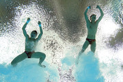 (L-R) Yuan Cao and Yanquan Zhang of China compete in the Men's Synchronised 10m Platform Diving on Day 3 of the London 2012 Olympic Games at the Aquatics Centre on July 30, 2012 in London, England.