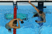 (L-R) Michael Phelps and Ryan Lochte of the United States look on after they competed in the first semifinal heat of the Men's 200m Individual Medleyon Day 5 of the London 2012 Olympic Games at the Aquatics Centre on August 1, 2012 in London, England.