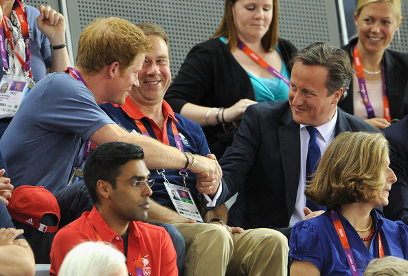 Prince Harry shakes hands with Prime Minister David cameron as they watch the track cycling on Day 6 of the London 2012 Olympic Games at Velodrome on August 2, 2012 in London, England.