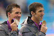 Gold medallist Michael Phelps of the United States and Silver medallist Ryan Lochte of the United States pose with the medals won in the Men's 200m Individual Medley final on Day 6 of the London 2012 Olympic Games at the Aquatics Centre on August 2, 2012 in London, England.