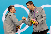 Gold medallist Michael Phelps (R) of the United States shakes hands Silver medallist Ryan Lochte of the United States on the podium during the medal ceremony for the Men's 200m Individual Medley final on Day 6 of the London 2012 Olympic Games at the Aquatics Centre on August 2, 2012 in London, England.