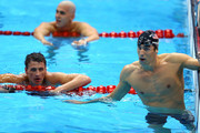 Gold medallist Michael Phelps (R) of the United States reacts along with silver medallist Ryan Lochte (L) of the United States and bronze medallist Laszlo Cseh (Top) of Hungary following the Men's 200m Individual Medley final on Day 6 of the London 2012 Olympic Games at the Aquatics Centre on August 2, 2012 in London, England.