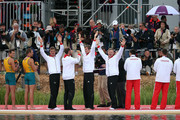 Photographers take pictures of Tim Grohmann, Lauritz Schoof, Phillipp Wende and Karl Schulze of Germany as they celebrate before receiving their gold medals during the medal ceremony for the Men's Quadruple Sculls final on Day 7 of the London 2012 Olympic Games at Eton Dorney on August 3, 2012 in Windsor, England.