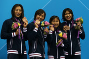 Bronze medallists (L-R) Aya Terakawa, Satomi Suzuki,  Yuka Kato, and Haruka Ueda of Japan pose on the podium during the medal ceremony for the Women's 4x100m medley Relay Final on Day 8 of the London 2012 Olympic Games at the Aquatics Centre on August 4, 2012 in London, England.
