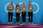 Gold medallists (L-R) Missy Franklin, Rebecca Soni, Dana Volmer, and Allison Schmitt of the United States pose on the podium during national anthem in the medal ceremony for the Women's 4x100m Meldey Relay Final on Day 8 of the London 2012 Olympic Games at the Aquatics Centre on August 4, 2012 in London, England.