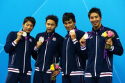 Silver medallists Ryosuke Irie, Kosuke Kitajima, Takeshi Matsuda and Takuro Fujii of Japan pose on the podium during the medal ceremony for the Men's 4x100m medley Relay Final on Day 8 of the London 2012 Olympic Games at the Aquatics Centre on August 4, 2012 in London, England.