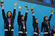 Bronze medallists (L-R) Aya Terakawa, Satomi Suzuki,  Yuka Kato, and Haruka Ueda of Japan celebrate on the podium during the medal ceremony for the Women's 4x100m medley Relay Final on Day 8 of the London 2012 Olympic Games at the Aquatics Centre on August 4, 2012 in London, England.