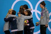 Gold medallists Dana Volmer, Rebecca Soni, Allison Schmitt and Missy Franklin of the United States embrace bronze medallists Japan on the podium during the medal ceremony for the Women's 4x100m medley Relay Final on Day 8 of the London 2012 Olympic Games at the Aquatics Centre on August 4, 2012 in London, England.
