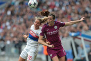 Amandine Henry (L) of Olympique Lyonnais jumps for the ball against Jill Scott of Manchester City Women during the UEFA Women's Champions League, Semi Final Second Leg match between Olympique Lyonnais and Manchester City at Groupama Stadium on April 29, 2018 in Lyon, France.