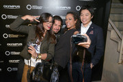"(l-r) Fernanda Brandao, Stephan Luca, Milka Loff Fernades and Akihiko Murata (General Manager Olympus Consumer Products Central Europe) attends opening of ""Olympus OM-D: Photography Playground"" on March 6, 2014 in Hamburg, Germany."