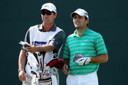 Francesco Molinari of Italy stands with his caddie Jason Hempelman on the second hole during the final round of the Omega Dubai Desert Classic at the Emirates Golf Club on February 12, 2012 in Dubai, United Arab Emirates.