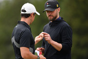 Singer Justin Timberlake of USA is given Rory McIlroy of Northern Ireland golf ball during the pro-am prior to the start of the Omega European Masters at Crans Montana Golf Club on August 28, 2019 in Crans-Montana, Switzerland.