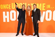 (L-R)  Brad Pitt, Margot Robbie and Leonardo DiCaprio attend the UK Premiere of 'Once Upon A Time In Hollywood' at Odeon Luxe Leicester Square on July 30, 2019 in London, England.