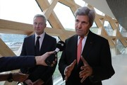 "Former US secretary of state John Kerry (R) speaks to journalists next to French Minister of Economy and Finance Bruno Le Maire (L) during the One Planet Summit on December 12, 2017 at La Seine Musicale venue on l'ile Seguin in Boulogne-Billancourt, west of Paris..?The French President hosts 50 world leaders for the ""One Planet Summit"", hoping to jump-start the transition to a greener economy two years after the historic Paris agreement to limit climate change. / AFP PHOTO / LUDOVIC MARIN"