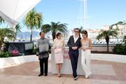 (L-R) Actor Vithaya Pansringarm, actress Kristin Scott Thomas, director Nicolas Winding Refn and actress Rhatha Phongam attend the 'Only God Forgives' Photocall during the 66th Annual Cannes Film Festival on May 22, 2013 in Cannes, France.