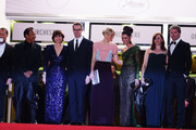 (L-R) Actors Vithaya Pansringarm, Kristin Scott Thomas, producer Lene Borglum, director Nicolas Winding Refn and is wife Liv Corfixen, actors Rhatha Phongam and Matthew Newman attend the 'Only God Forgives' Premiere during the 66th Annual Cannes Film Festival at Palais des Festivals on May 22, 2013 in Cannes, France.