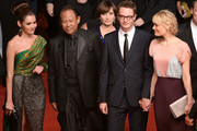 (L-R)  Actress Rhatha Phongam, actor Vithaya Pansringarm, actress Kristin Scott Thomas, director Nicolas Winding Refn, and Liv Corfixen attend the 'Only God Forgives' Premiere during the 66th Annual Cannes Film Festival at Palais des Festivals on May 22, 2013 in Cannes, France.