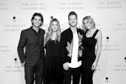 ((Editors Note: Image has been converted to black & white)  Owner and CEO of Onsite Miles Adcox, actress Vanessa Lee Evigan, Tyler Hubbard of musical duo Florida Georiga Line and Hayley Hubbard attend the 2018 Inspire event by The Onsite Foundation at Marathon Music Works on October 23, 2018 in Nashville, Tennessee.