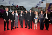 French actress and President of the Jury Catherine Deneuve (3ndR) poses with members of the Jury (From L) French sound engineer Jean Pierre Duret, French musician Orelsan, French director Nicolas Saada, French actor Gaspard Ulliel, French Scriptwriter Antonin Baudry, Luxembourgish actress Vicky Krieps and French director Claire Burger during the Opening Ceremony of the 45th Deauville American Film Festival on September 06, 2019 in Deauville, France.